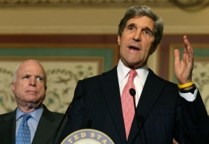 Senator John Kerry (D-MA) argues for CRPD while Senator John McCain (R-AZ) looks on.